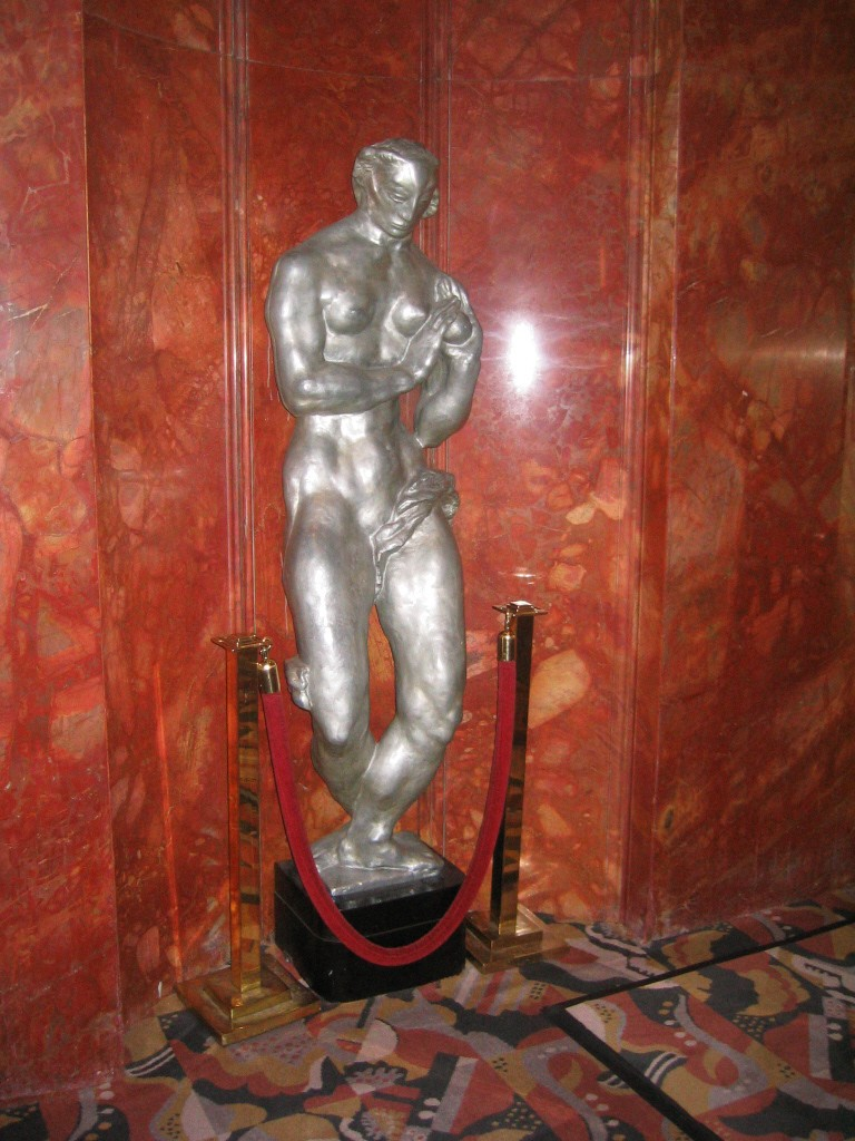 "Photographed by Andreas Praefcke, via WikiCommons. Aluminum sculpture ""Eve"" by Gwen Lux is installed against a marble wall."