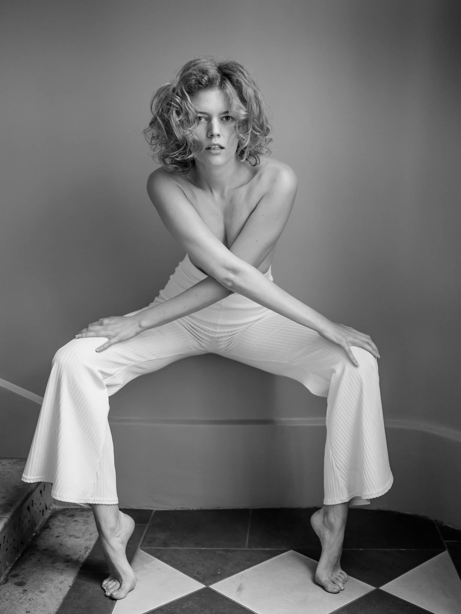 The model Kate poses for the black and white portrait by the professional photographer Damien Lovegrove, a RYDE client.