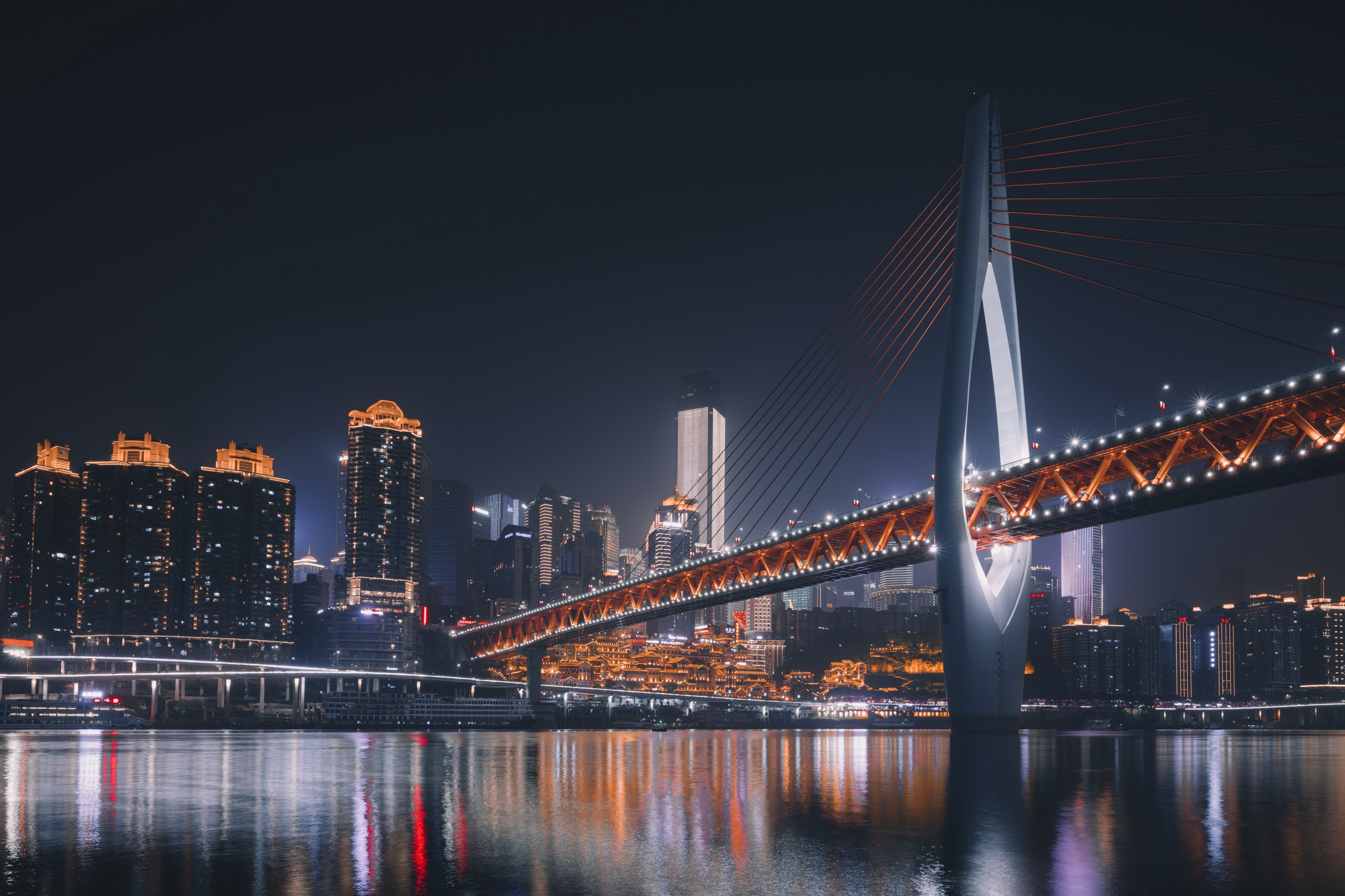A night picture of a large, lighted bridge in China