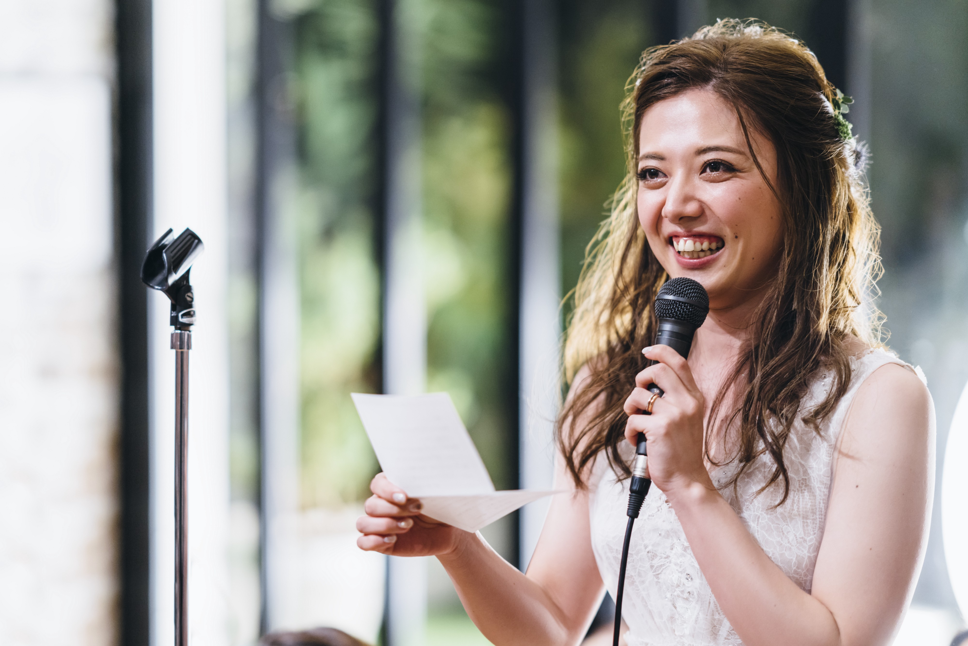 A young woman is giving speech during an event.