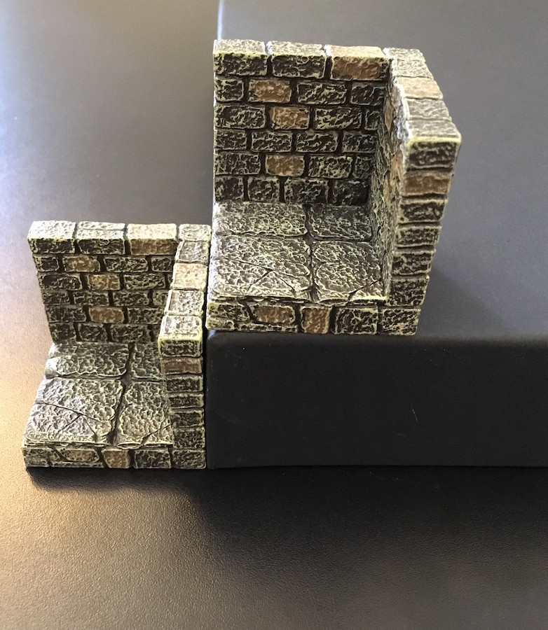 A Dwarvenforge wall+floor piece sits beside a GRÅSIDAN paper tray turned upside down. They are the same height.