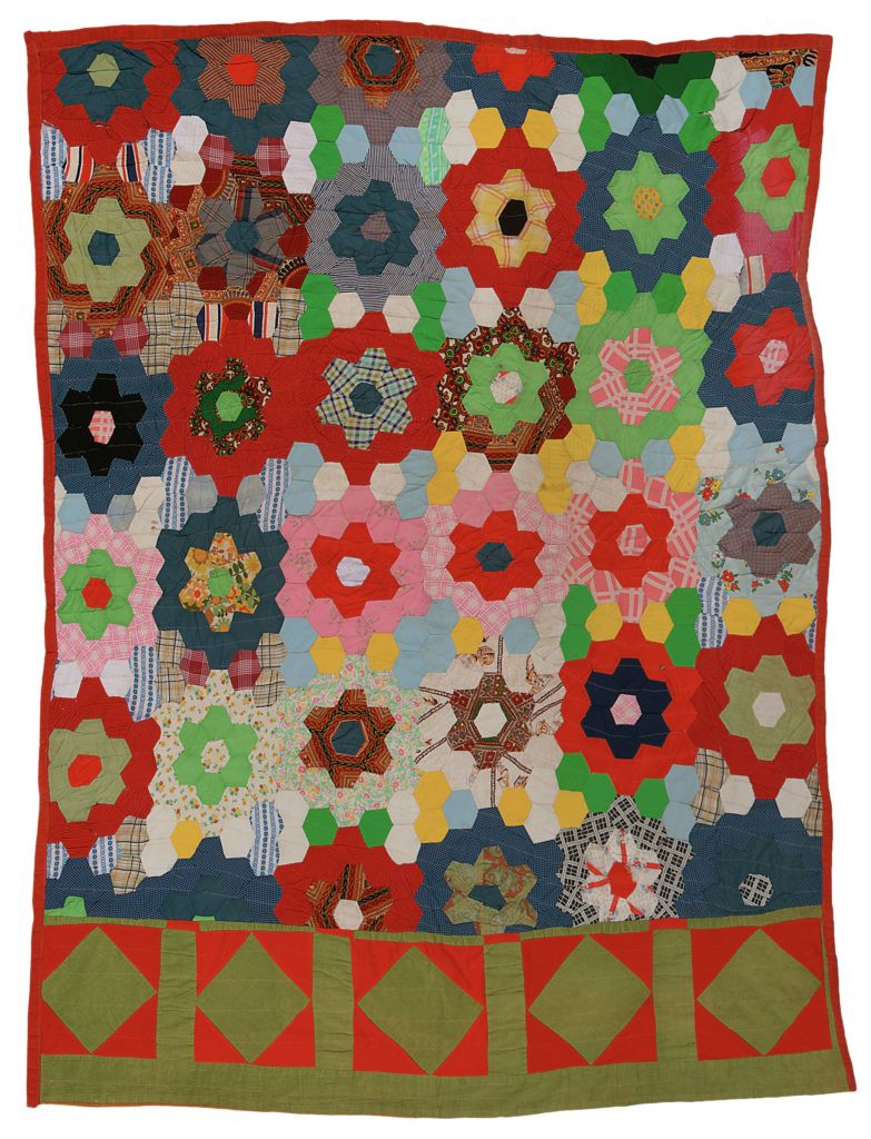 Brightly-colored quilt depicting rows of flowers and a band of diamonds at the bottom.