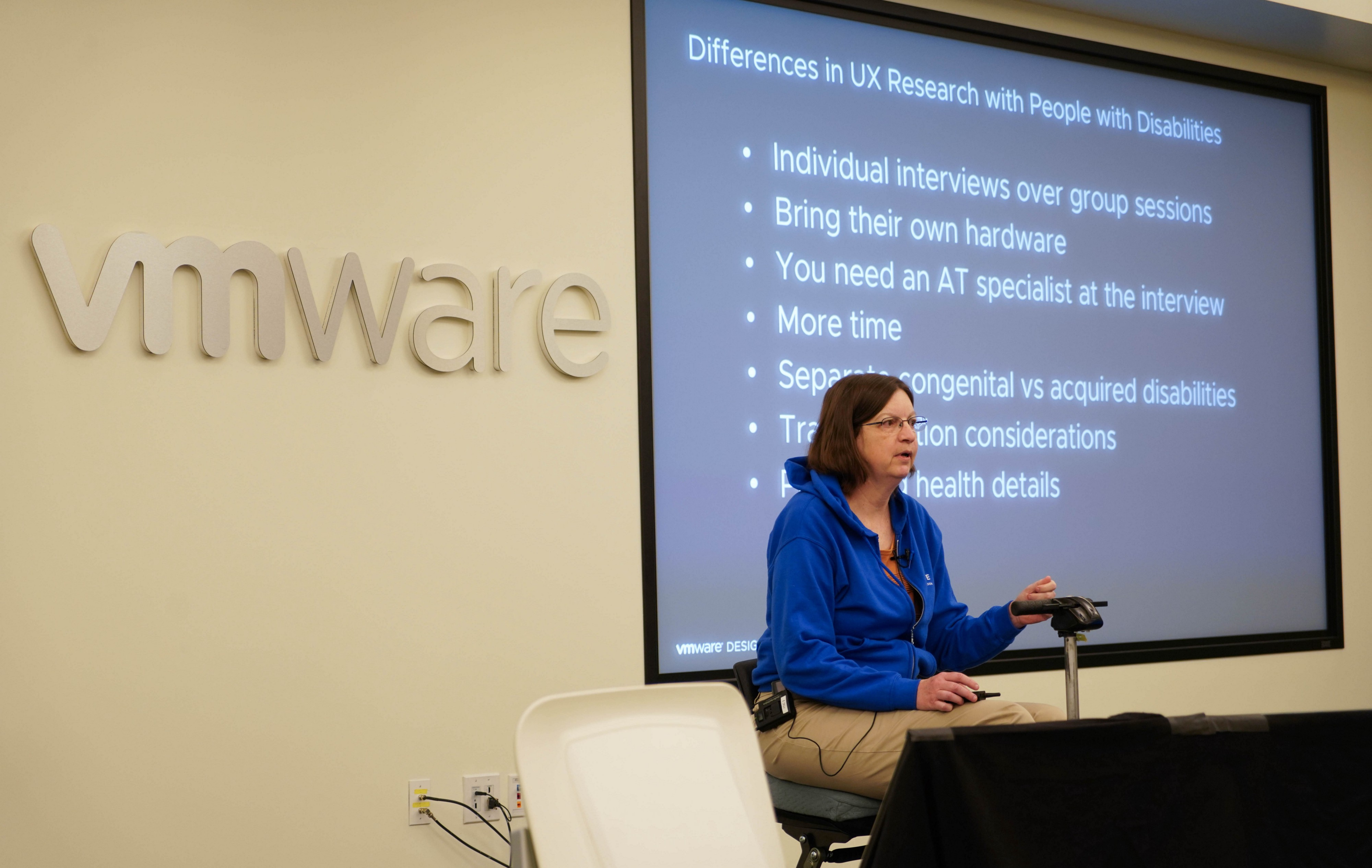Sheri speaking on stage at our design conference about recruiting users with disabilities for research
