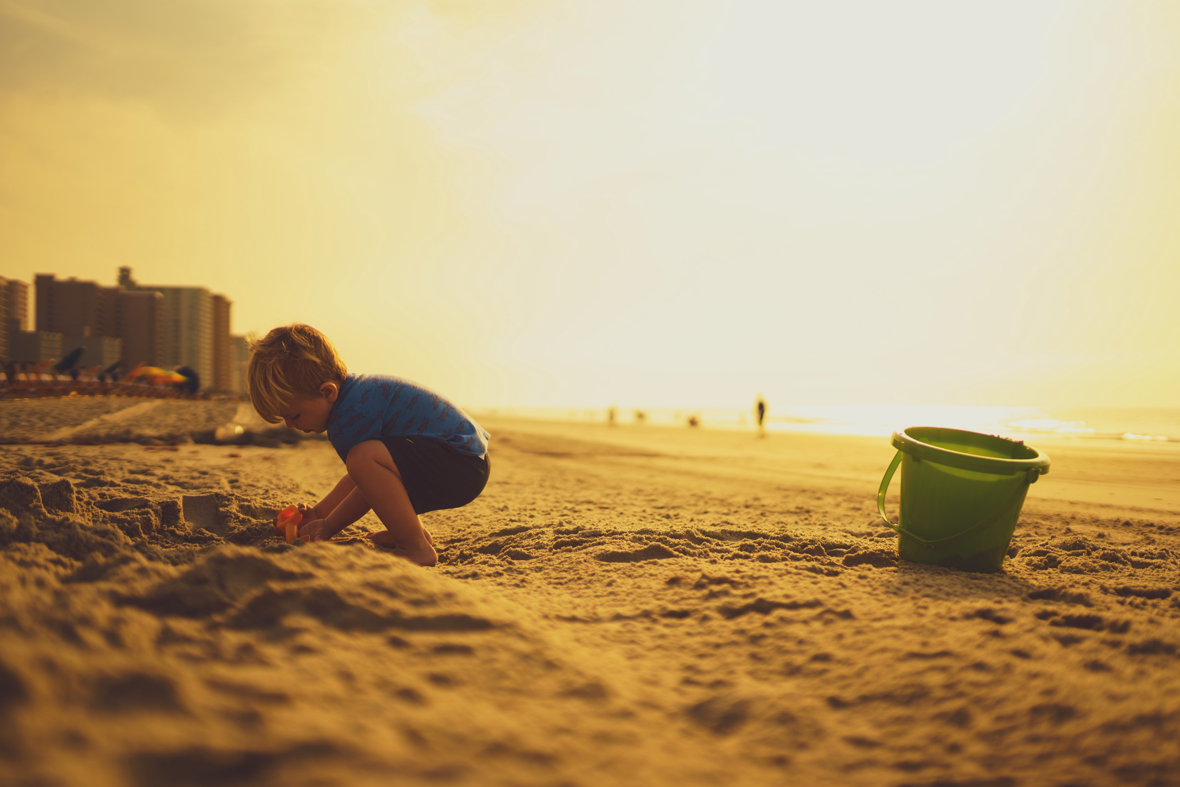 A child plays in the sand