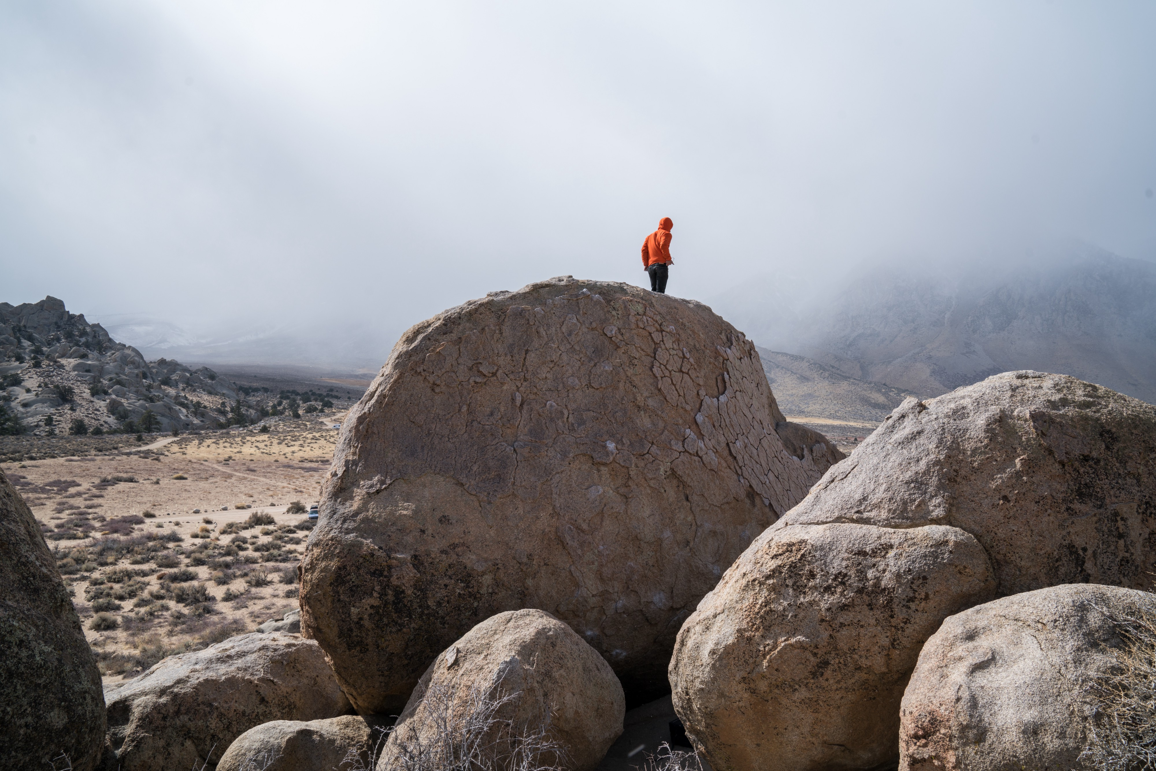 Person Standing on top of a boulder