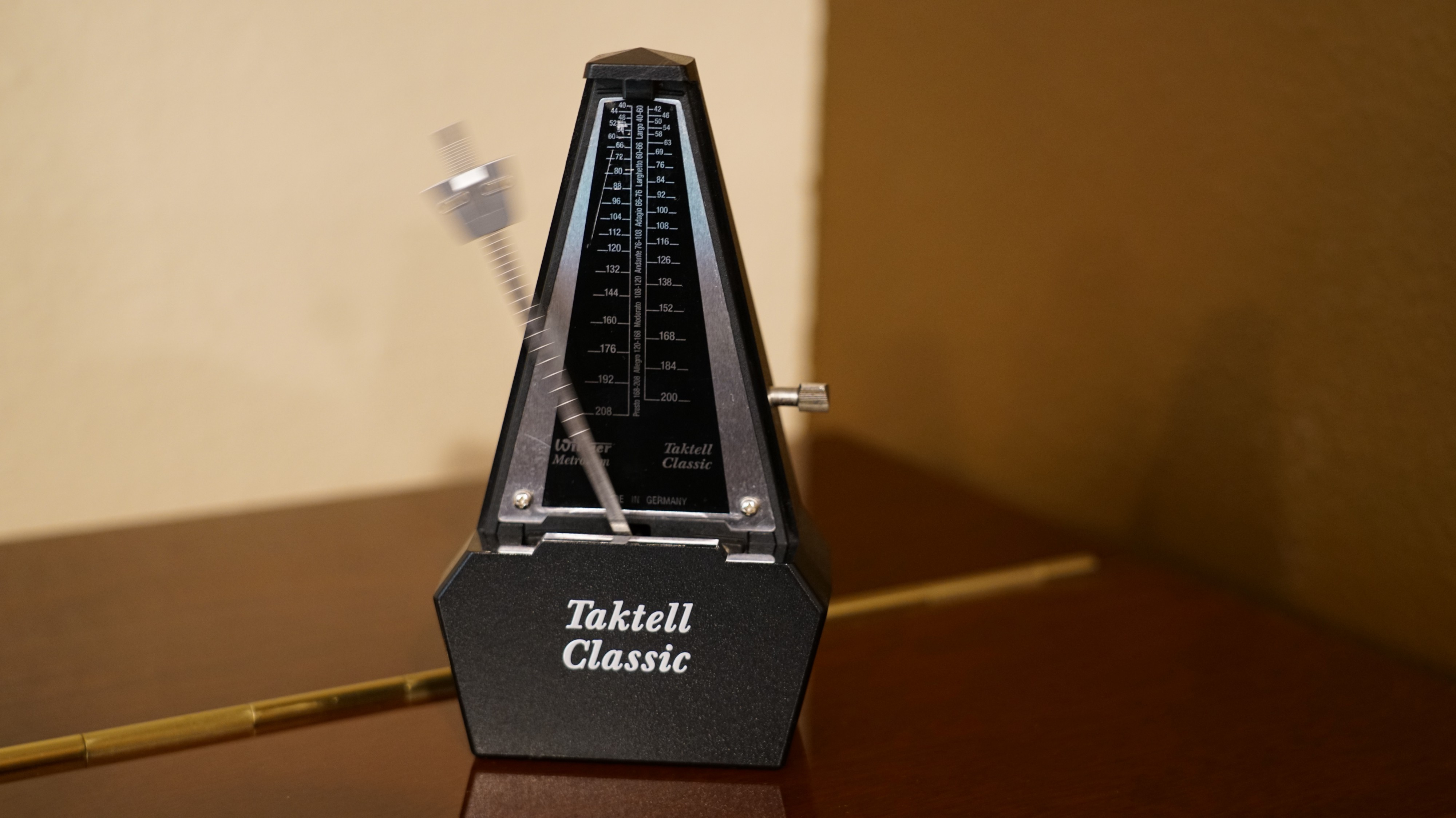 Mechanical metronome of limited adjustability and accuracy.