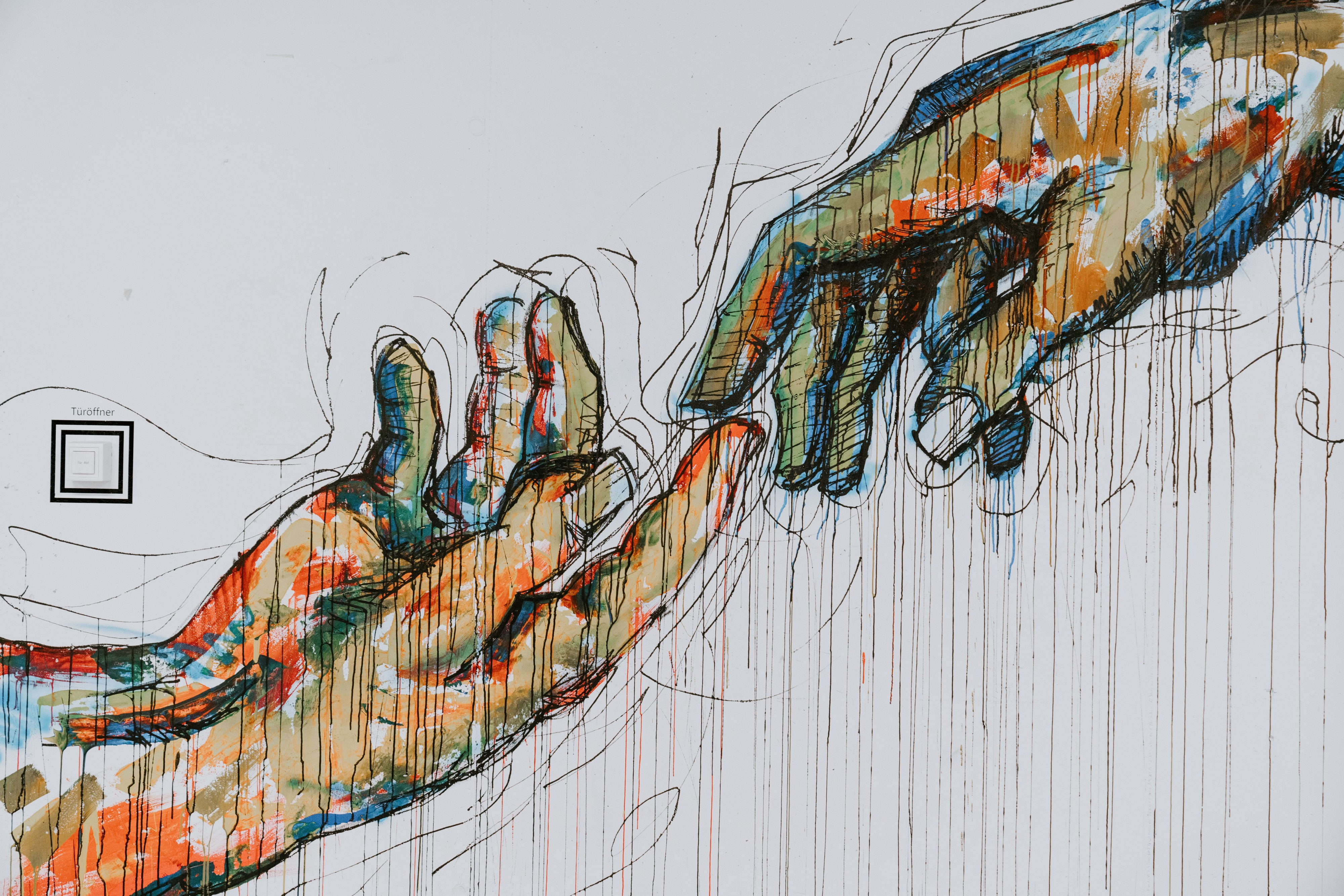 Sketches of hands where one person's seems to be lifting the other