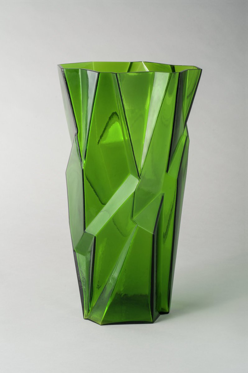 Green faceted glass vase.