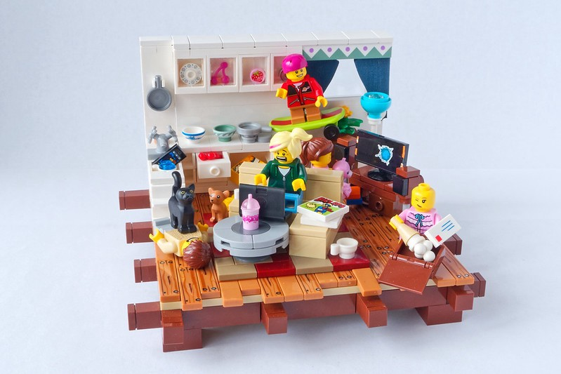 Lego figurines depicting a harassed person trying to work from home with children wreaking havoc