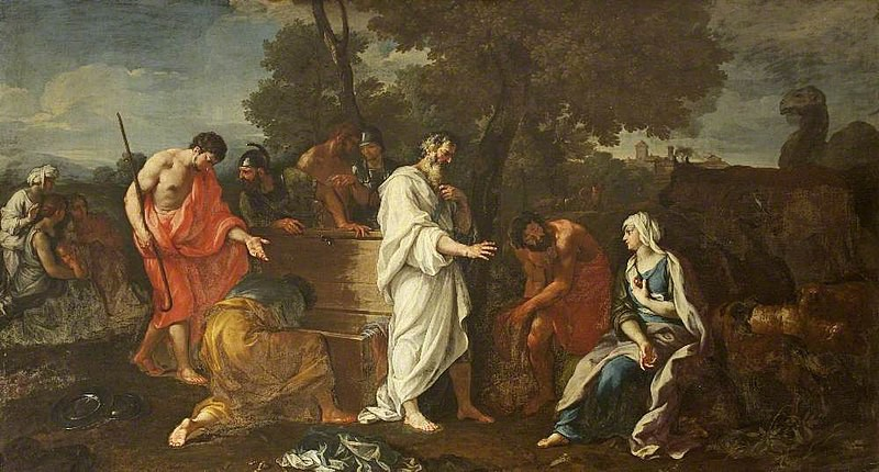 A woman with a white head covering and blue dress sits to the side as men search her trunk and other possessions for her father's household gods