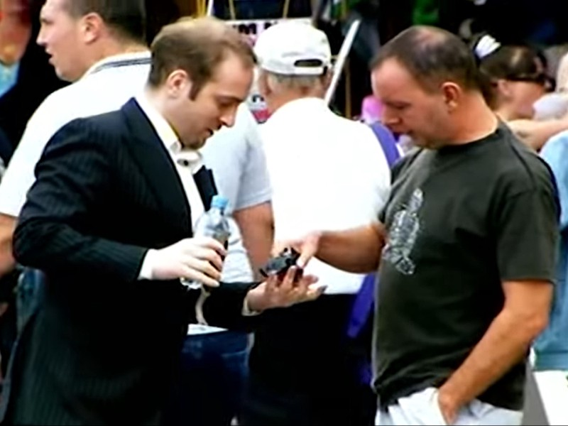 A random bloke handing over his possessions to mentalist Derren Brown
