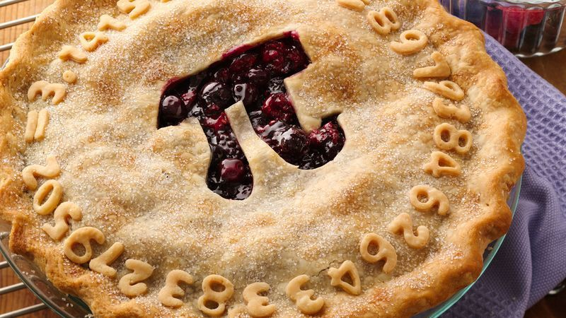 "A cherry pie with a cutout ""pi"" symbol in the center and the numbers of pi around the border."