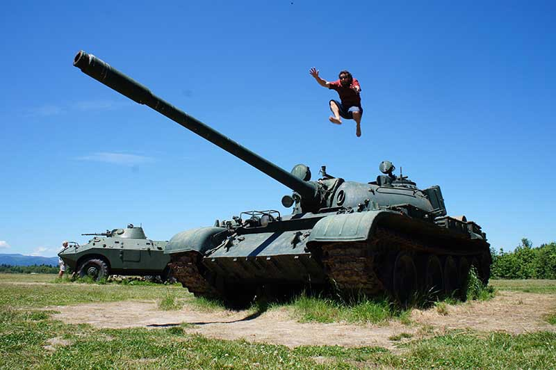 man leaps from armoured tank