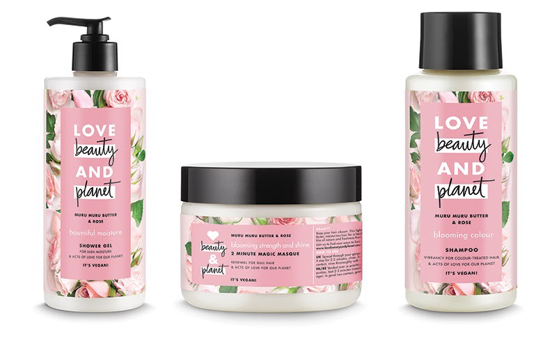 """Photo of """"Love, Beauty and Planet"""" products. Three bottles, pink labels with brand name and pink flowers."""