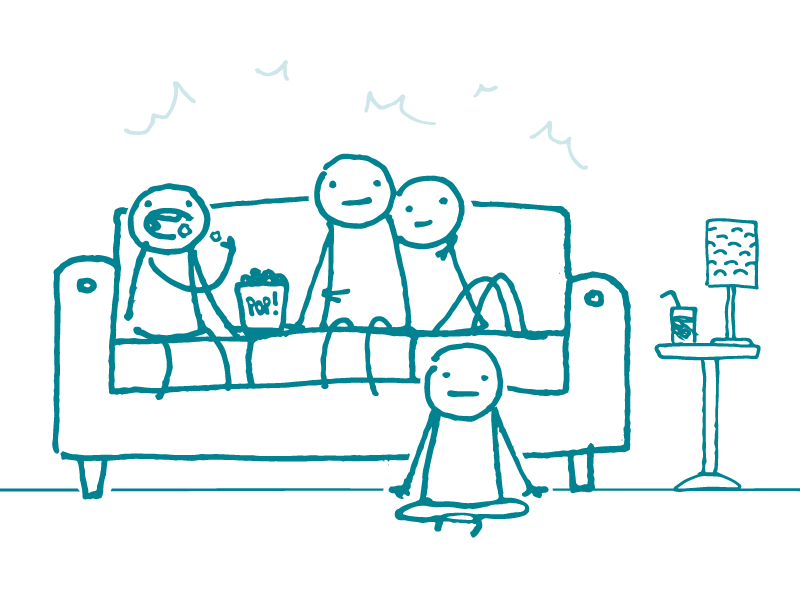 Four doodles are gathered in a living room staring forward, as if watching a screen. One is eating popcorn.