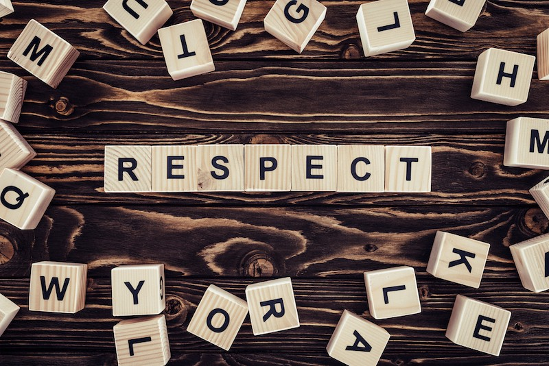 The word RESPECT spelled with wooden tiles