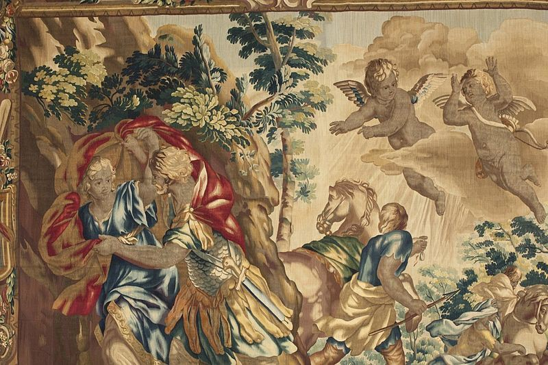 A colorful antique tapestry depicting Aeneas' flight from Troy.