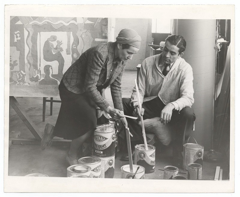 Photographed by Horvath. (Archives of American Art, Smithsonian Institution.) Ruth Reeves and an assistant prepare paint.