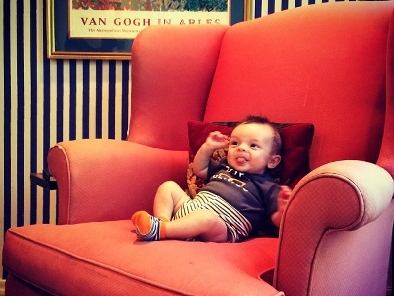 A 3-month old baby in a large armchair