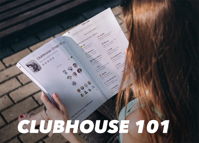 A girl holding a magazine that contains information about the Clubhouse.