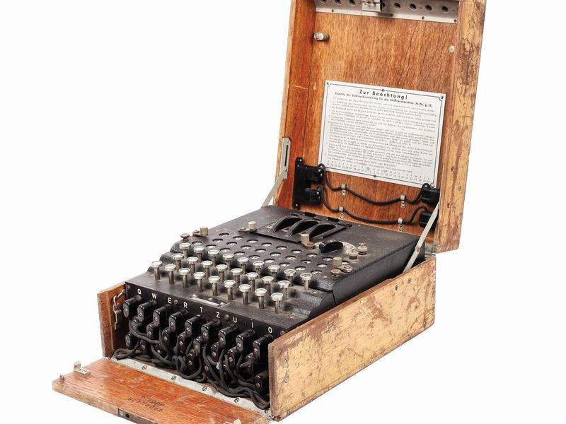 An wooden book containing metal keys and plugs