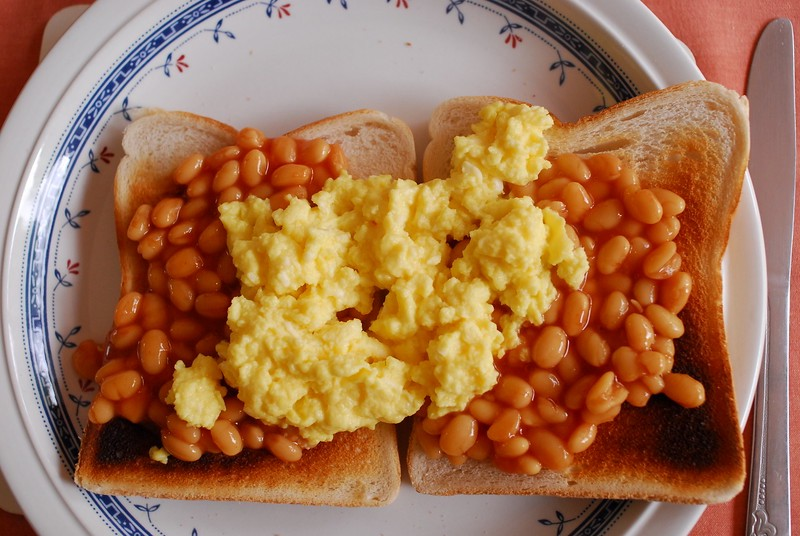 Baked beans with scrambled egg on toast