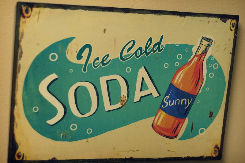 Antique metal advertising panel for Ice Cold Soda (called Sunny)