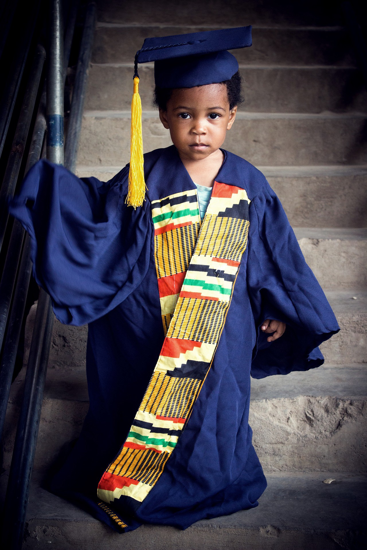 Child wearing graduation robes