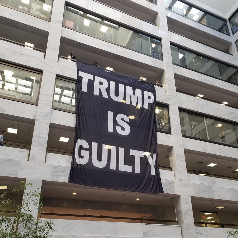 trump is guilty banner in senate office bldg