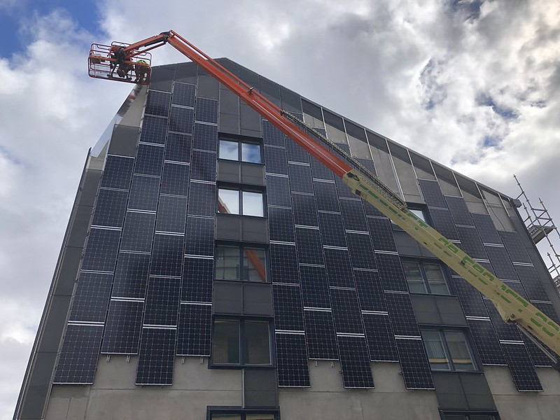 A building covered in solar panels to collect renewable solar energy.