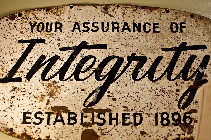 sign that says, your assurance of integrity.