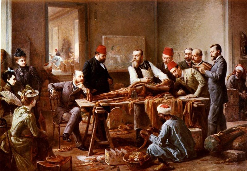 Painting of mummified body being examined by a group of men. Some are wearing red fez hats. A crowd of women are watching the examination.