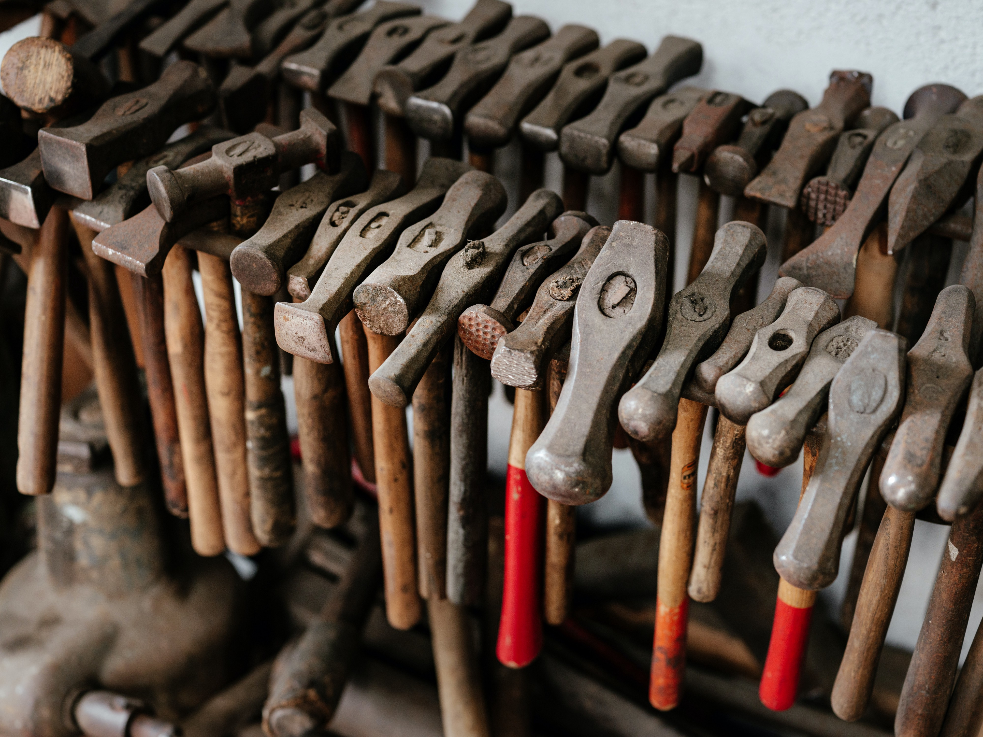 A rack full of different types of hammers