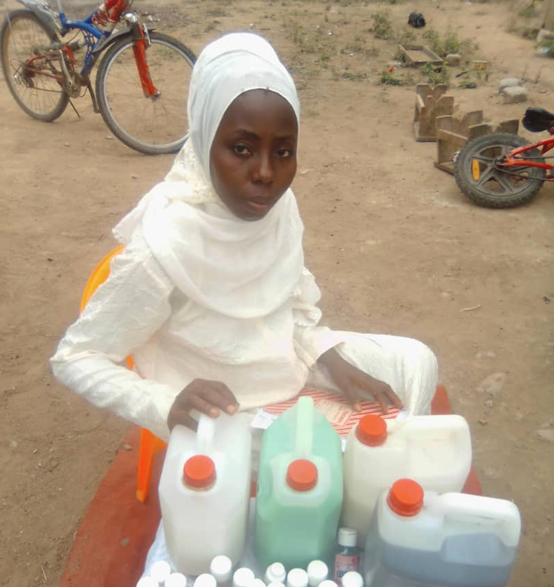 Sakina Ansah of Central Region, Ghana, showing her hand sanitiser and other detergent products, which are used in local hospitals.