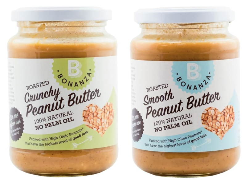 Two jars of no palm oil peanut butter in front of a white background