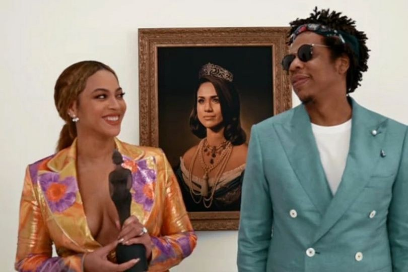 beyonce and jay-z in front of portrait of meghan markle
