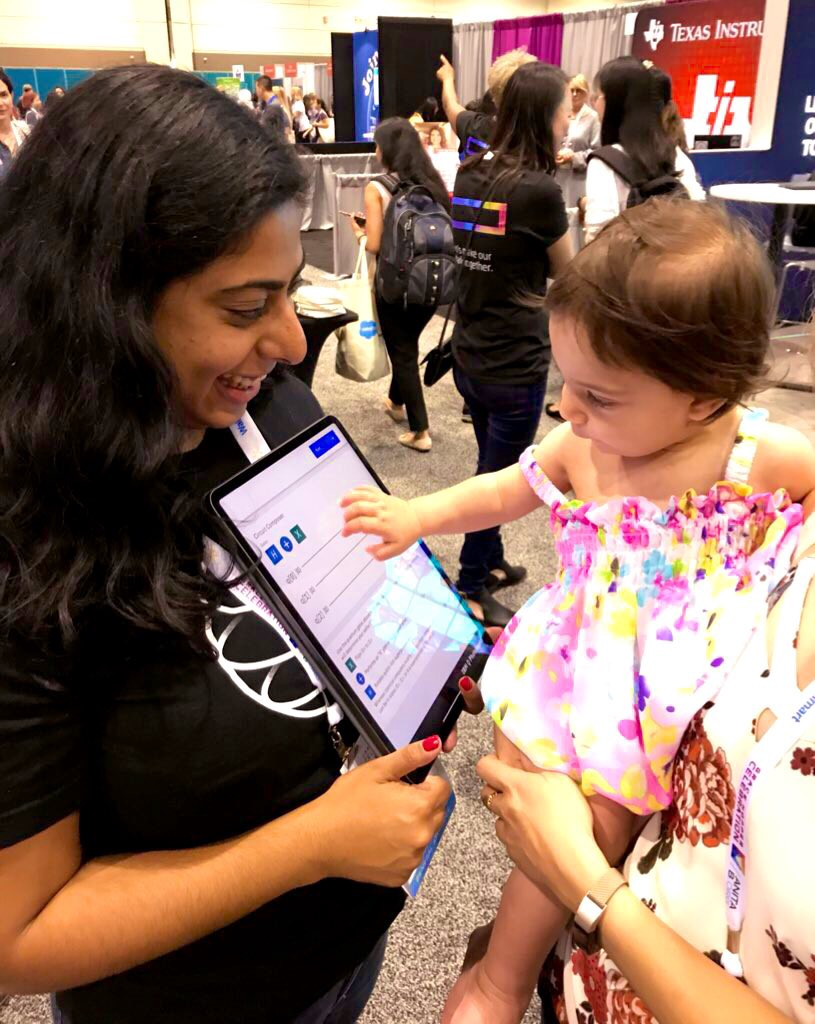 woman holding ipad, baby touching ipad
