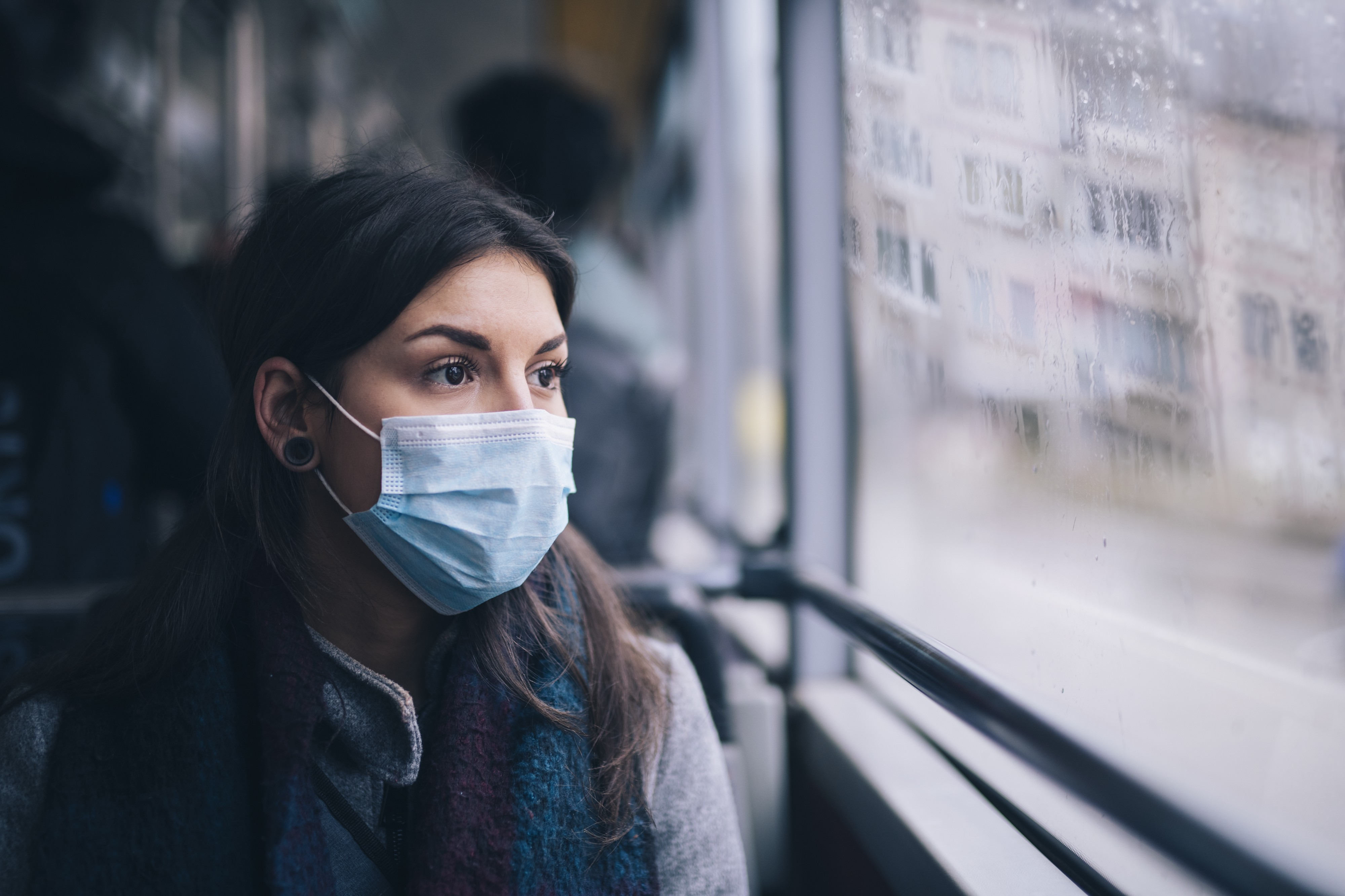 Woman wearing face mask riding the bus.