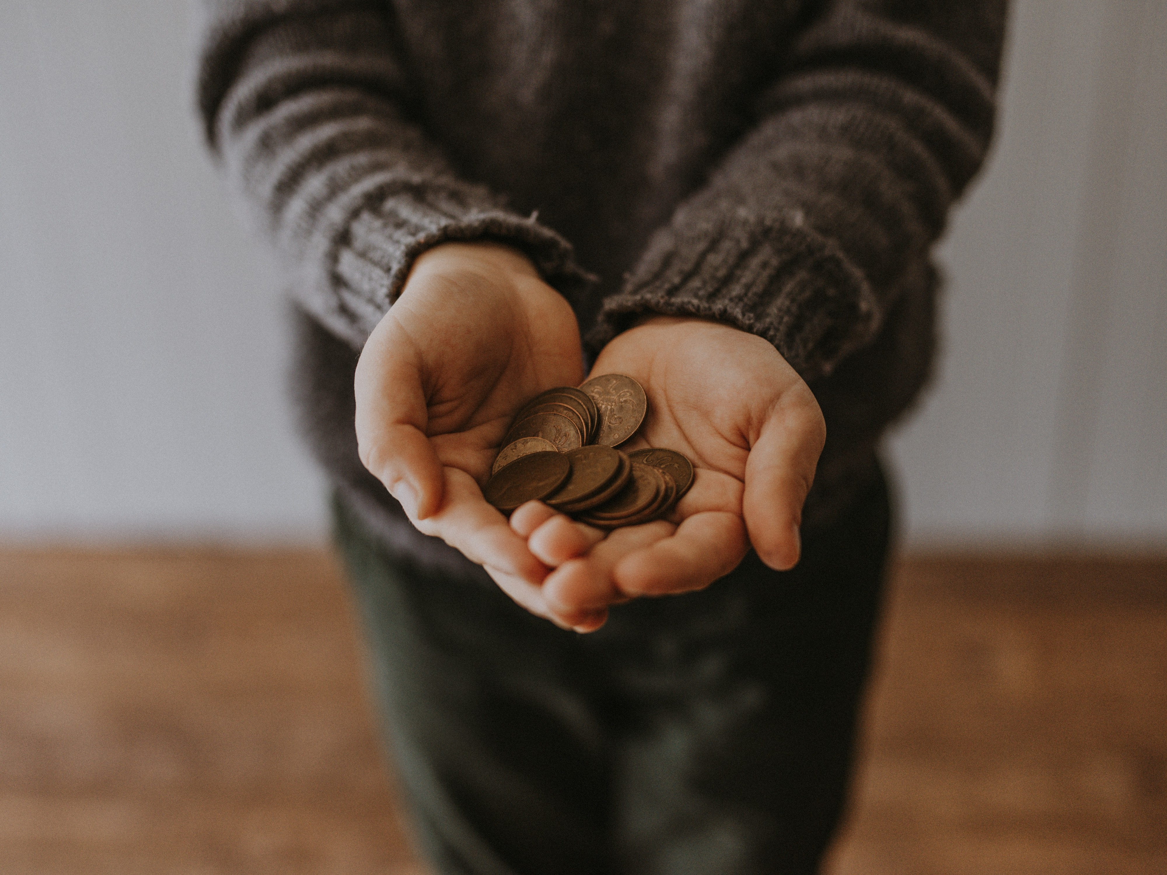 Person holding a hand full of pennies