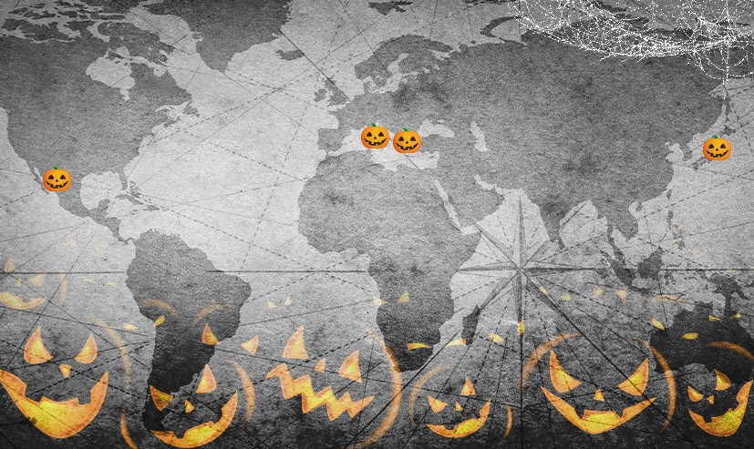 A black & white map w/ pumpkins on top of Mexico, Greece, Italy & Japan. Silhouettes of jack'o lanterns line the bottom