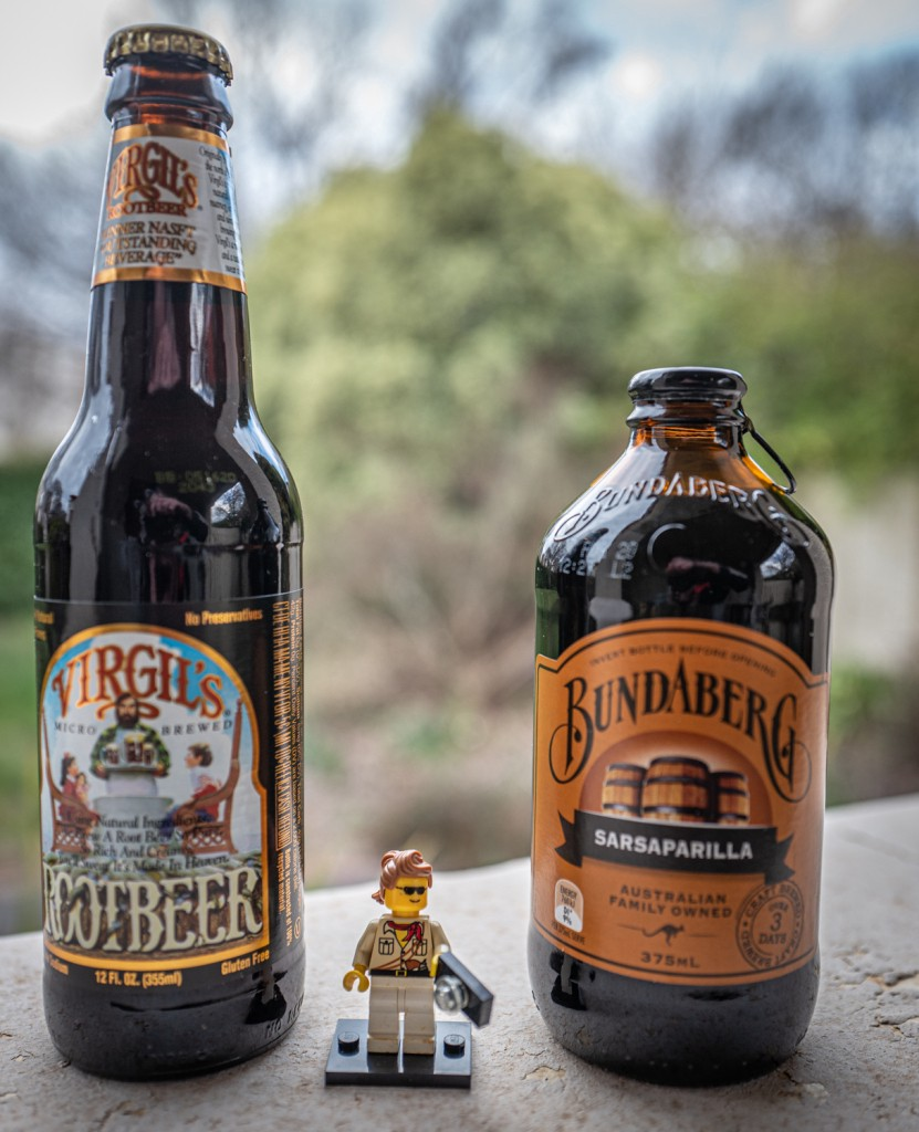 Two bottles of soft drink: Virgil's root beer in the tall bottle, and a stubby of Bundaberg Sarsaparilla