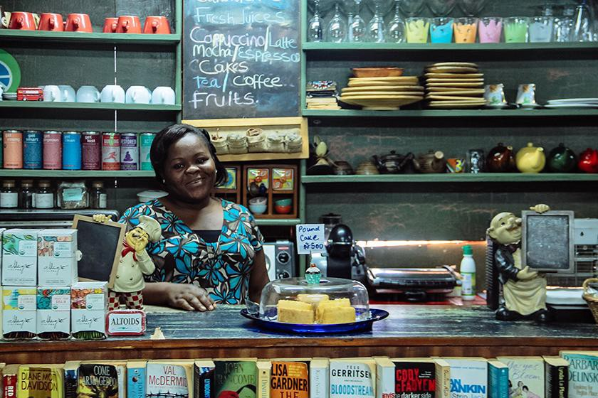 One of Tundun Tejuoso's employees helps out in the bookstore café, which opened in the early 2000s. (Photo: Ginikachi Eloka,