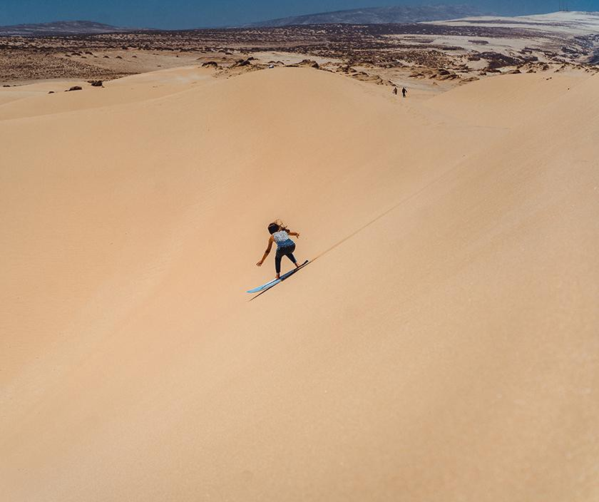 When the surf is flat, towering dunescapes become the next best option for speed and cross-training. (Photo: Simon Guillemin,