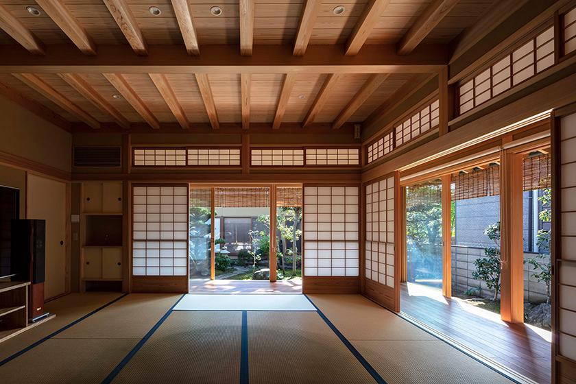 Takashi Okuno & Associates' family house in Tadotsu has windows sheltered by traditional timber screens and deep eaves, givin