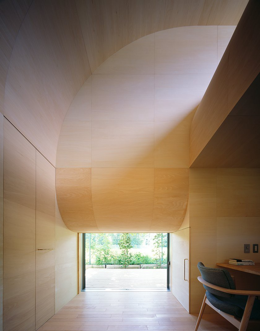 Inside, basswood lines the walls, floor, and roof. A small window on the right-hand side of the desk provides natural light.