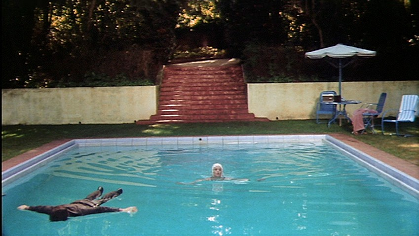 Bud Cort as Harold floats in the swimming pool in an apparent suicide while Vivian Pickles as his mother swims.