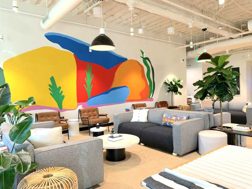 Photograph of the empty Porsche Digital office in San Jose, colorful walls and lounge area