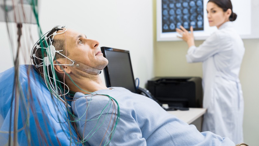 An EEG records electrical brain activity as it happens