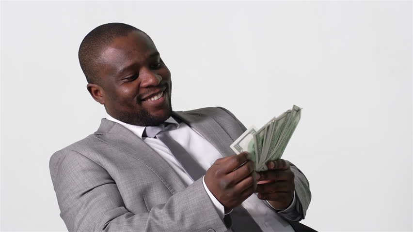Smiling African Letting Agent counting cash
