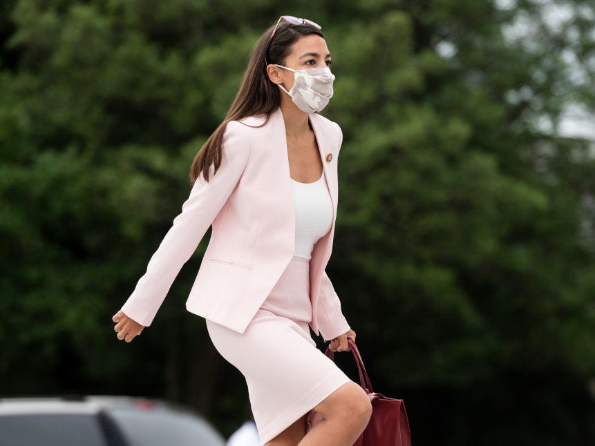 Rep. Alexandria Ocasio-Cortez, D-N.Y., walks up the House steps for a vote in the Capitol on Thursday, Sept. 17, 2020.